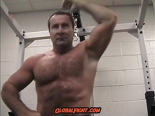 Older muscleman daddy flexing gym...