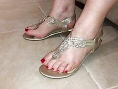 Classy gold thong sandals and sexy feet