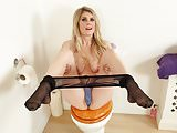 English milf Ashleigh gets naughty on the toilet