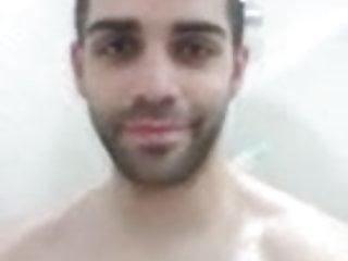 Spaniard man taking a shower