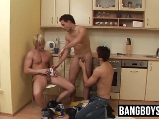 Three jocks are stretching each others asses in the kitchen