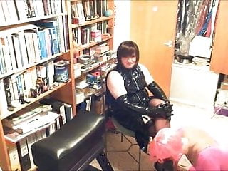 Dolly dressed in sissy pink lycra worships feet