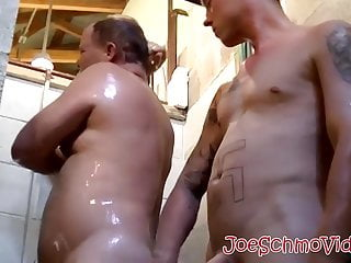 Mature fat gay takes a bath with young big cocked jock