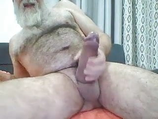 Old bearded grandpa has a monster cock