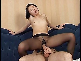 Asian babe gets cum on her black pantyhose...