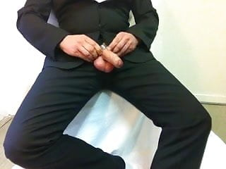 Cumshot in suit with cock cage...