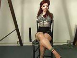 a redhead sitting pretty