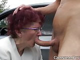Redhead grandma sucks off young stud at secret outdoor place