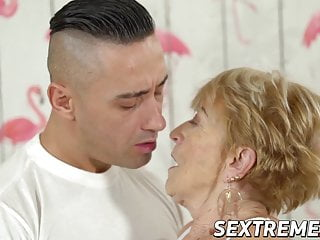 Elegant mature lady takes young cock balls deep in her pussy