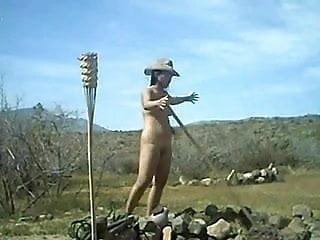 Nude female farm worker outdoor