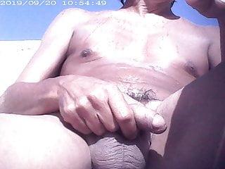 Beach nudist cock play...
