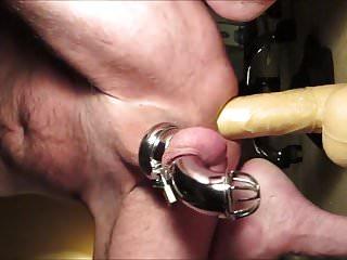 Prostate milking in chastity dildo...