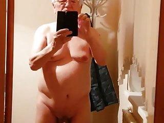 Kazakh grandpa in front of a mirror