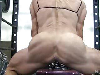 Muscle babe fucks a dildo gym...