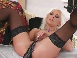 Petite blonde teases in lingerie