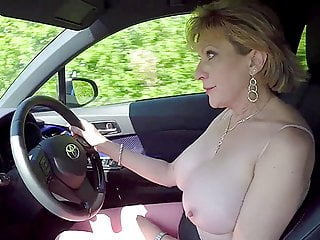Mature blonde her tits while driving...