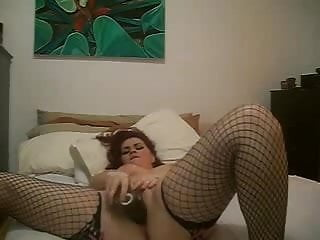 Chubby girl fucking herself with a big plastic cock