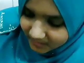 Hijabi girl sucking