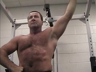 Hairy Bodybuilder Muscledaddy Flexing Muscles in Gym