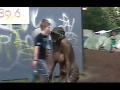 Topless Danish girl covered in mud at Roskilde Festival