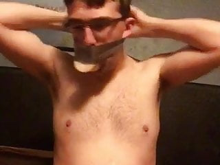 So Hilarious – twink fag gagged himself with dildo and tape