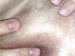 Massaging her hard plump clit