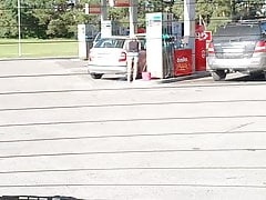 Mature legs at petrol station