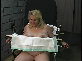 Candy gets restrained on a chair with leather cuffs
