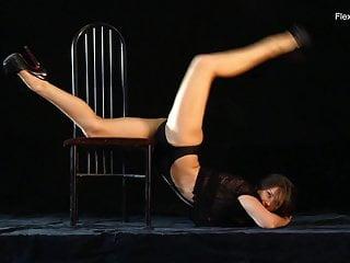 Naked gymnast Kim Nadara doing gymnastics on chair