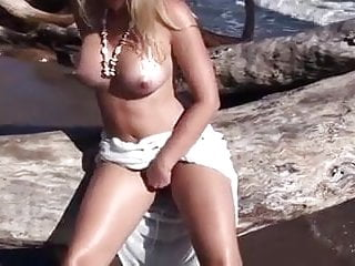 Lovely blonde plays by the sea...