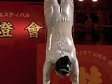 GORGEOUS CHINESE GIRL PERFORMING DEATH DEFYING STUNT
