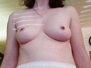Wife posing in leggings topless vid...