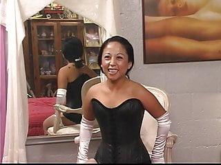 Cute slave girl in corset has nipples tortured...