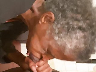 Black gives gumjob to big black dick...