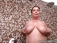 Redhead uses a big dildo to stretch her wet pussy in the shower