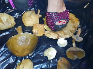 Lady L crush  mushrooms with extreme gaga high heels.