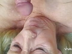 Granny with big tits gives blowjob