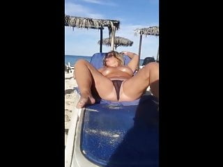 herself with plays MILF Beach